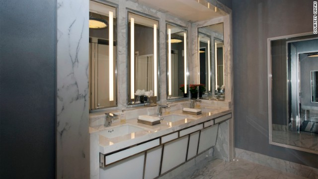 The ladies' lounge features an Art Deco staircase, marble vanity and a bathroom attendant. Each private stall includes a toilet, vanity, porcelain sink and Salvatore Ferragamo products.