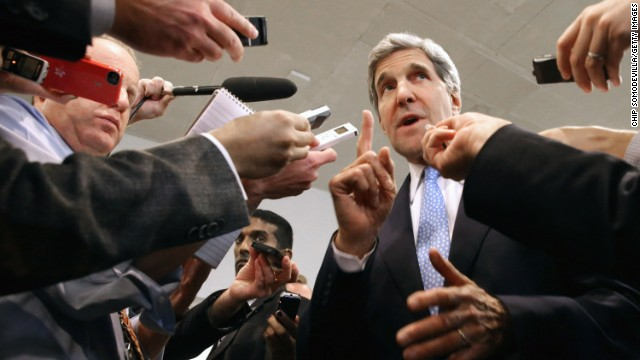U.S. Secretary of State John Kerry speaks with reporters before briefing a Senate committee on negotiations with Iran.