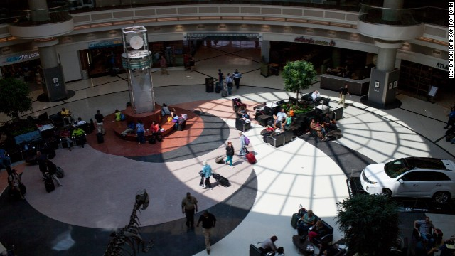 People pass through the Domestic Terminal atrium.