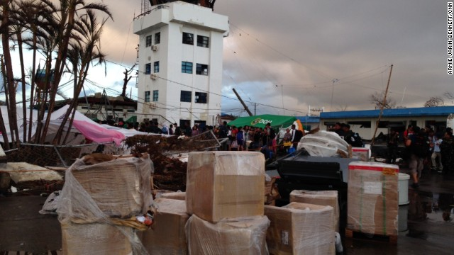 Relief aid waits to be distributed at Tacloban's battered and chaotic airport on November 13.
