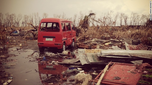 An abandoned van lies amid the vast sea of debris around a village close to Tacloban's airport on November 14.