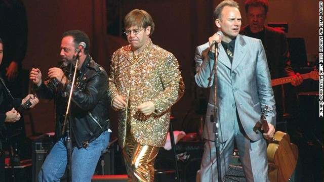 Billy Joel, John and Sting perform at a benefit concert for the Rainforest Foundation in 1995.
