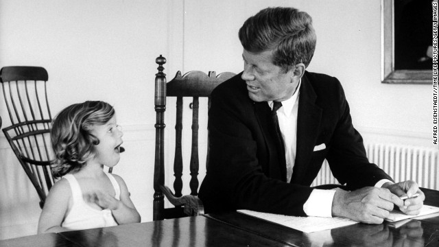 Sen. Kennedy takes a break from work to talk with Caroline at their Washington home in 1960.