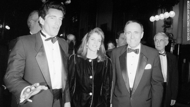 Kennedy spends time with her brother, left, and New York Mayor Rudy Giuliani in 1994.