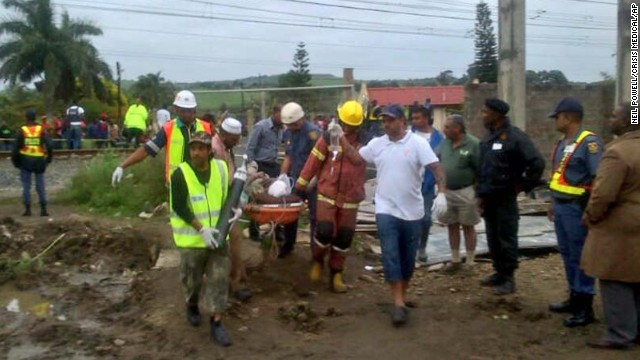 Medical personnel carry an injured person from the site of the collapse.