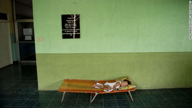 A child sleeps in a hallway outside the overcrowded children's and maternity ward at the Eastern Visayas Medical Center on November 20.