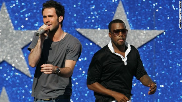 Levine sings with Kanye West in Los Angeles in 2005.