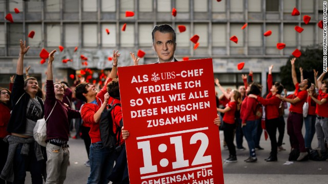 Supporters of the Swiss 1:12 initiative demonstrate in Zurich on November 2.