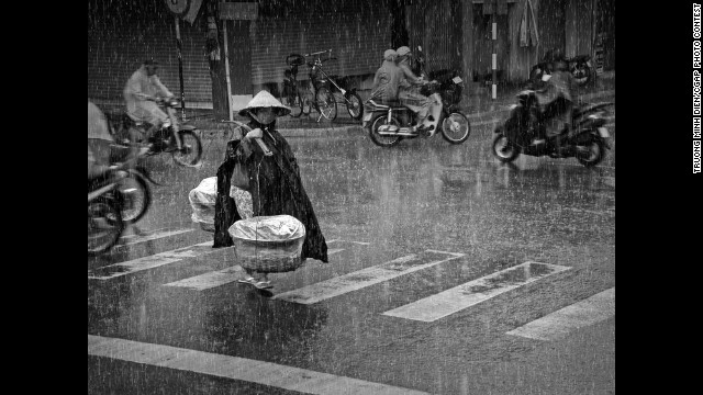 In Vietnam, a woman transports potatoes to sell at a local market. This is the Grand Prize winner.