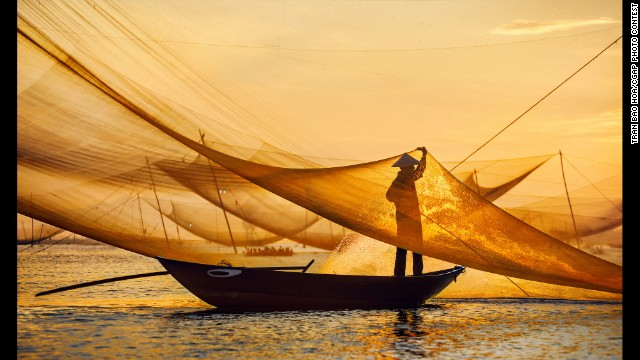 This Vietnamese man tends to his fishing nets in the morning and sells his catch at the local markets in the afternoon.