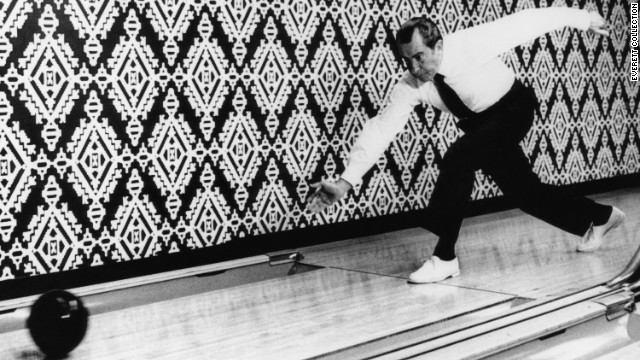 President Richard Nixon and first lady Pat Nixon both liked to bowl. The Nixons were responsible for moving the White House bowling alley back into the Executive Mansion after it had been relocated years earlier to a nearby building. Here Nixon bowls in 1971.