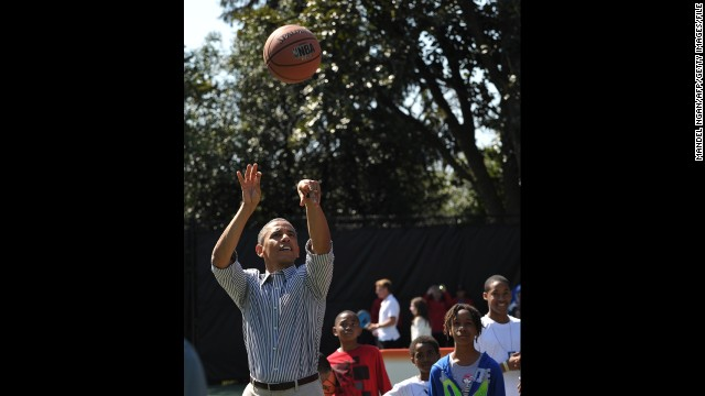 In addition to regularly playing golf, President Barack Obama also enjoys a game of basketball. Here he takes a shot during the Easter Egg Roll at the White House in April 2013.