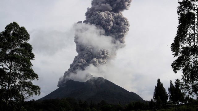 The Sinabung volcano erupts and spews hot smoke in Karo, Indonesia, on November 10.