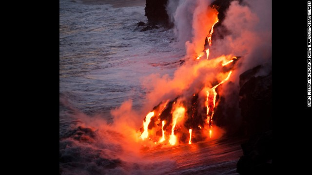 Lava from the Puu Oo cone of Kilauea Volcano reaches the Pacific Ocean on the southeastern coast of Hawaii Island, Hawaii, on Monday evening, January 7, 2013. Puu Oo has been erupting for more than 30 years. This eruption, on the volcano's east rift, began January 3, 1983.