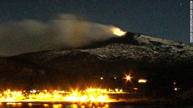 The Copahue volcano emits smoke and ash above Caviahue, in Argentina's Neuquen province, on December 24, 2012.