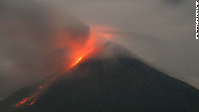 "Western Mexico's Colima volcano emits lava on October 2, 2004. The Global Volcanism Program reported ""a bright thermal anomaly"" as well as gas emission on November 9, 2013."