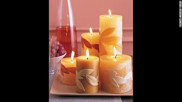 Leaf-covered candles: <a href='http://www.marthastewart.com/269676/leaf-covered-candles?xsc=synd_cnn' target='_blank'>Make your own candles</a> with natural leaves.