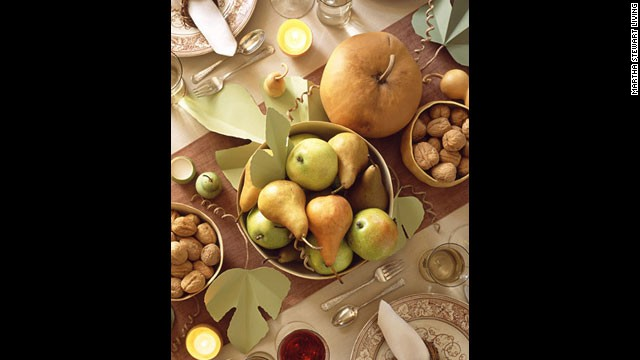 Harvest table: This centerpiece is <a href='http://www.marthastewart.com/264215/setting-a-thanksgiving-table' target='_blank'>grounded by hollowed-out gourds</a>.