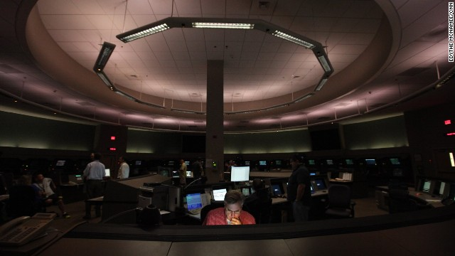 Inside the Federal Aviation Administration's Terminal Radar Approach Control, or TRACON, Ken Hunihan monitors the systems that air traffic controllers use, including radar antennas and communication towers.