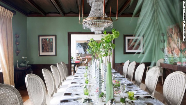 This dining room, decorated by Nicolette Horn and featured in the October 2013 issue of House Beautiful, includes very traditional but very dramatic furniture and fixtures.