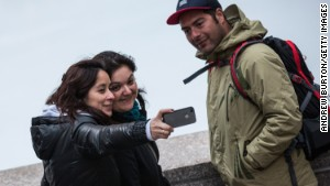 Who takes more selfies: Women or men?
