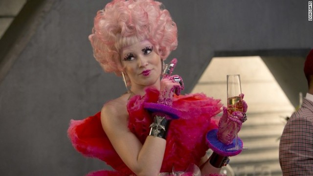 "<strong>Special Skill:</strong> Punctuality; positive reinforcement <strong>Shining Moment:</strong> ""Chins up, smiles on!"" Effie is nothing if not concerned with appearances, but it's the cracks in her veneer in ""Fire"" that make the character truly shine."