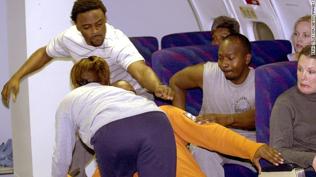 """He kicked someone's seat-back."" Airplane Irritant No. 1 invites a violent response."