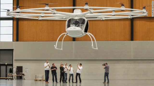 German engineers celebrate as the Volocopter, one of the world's first electric helicopters, takes off on its maiden flight.