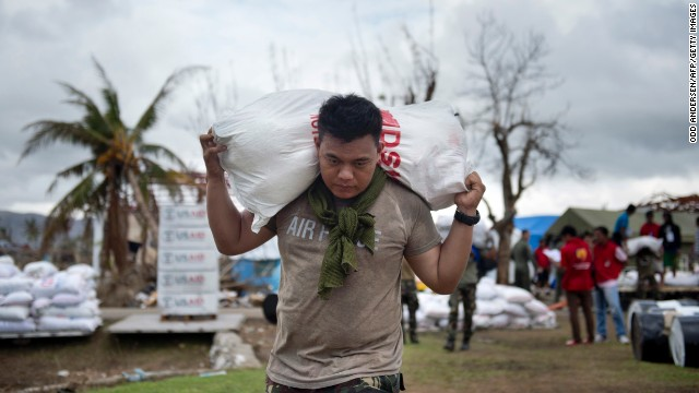 A Philippine Air Force crew member loads aid onto a helicopter at the airport in Tacloban, Philippines, on Friday, November 22.