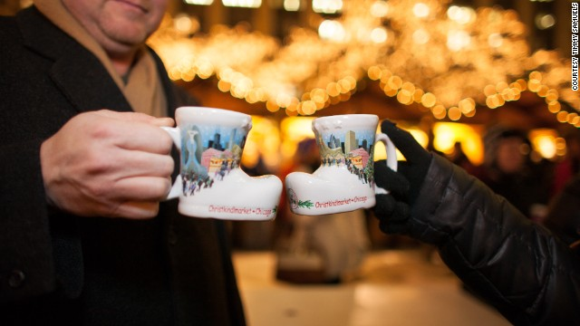Revelers clink commemorative mugs at Chicago's Christmas market.