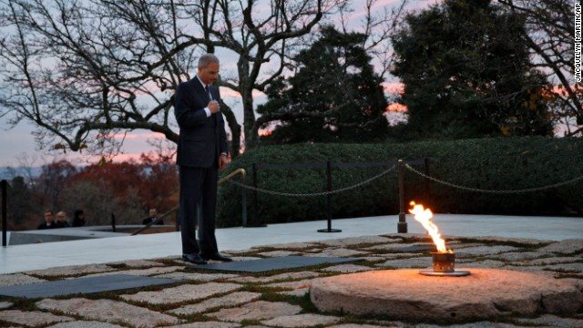 Attorney General Eric Holder pays his respects at Kennedy's grave on November 22. Holder has been visiting the grave since his youth, and he used to come with his mother before she passed away.