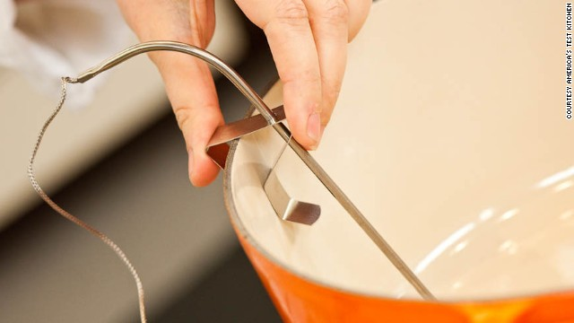To monitor the oil temperature, it's best to use a thermometer that clips to the side of the pot.