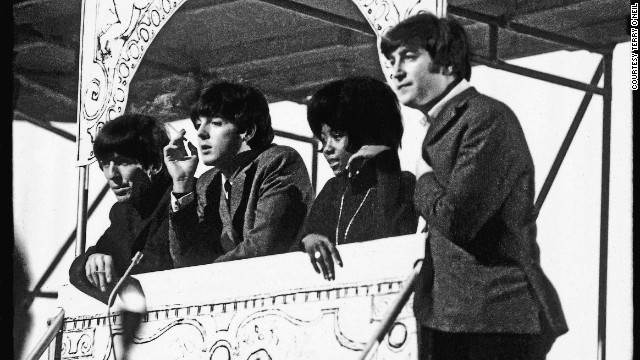 "Within a year of ""Please Please Me,"" the Beatles had performed before 75 million Americans on <i>The Ed Sullivan Show</i> and flown home to film <i>A Hard Day's Night </i>and record <i>Around the Beatles.</i>"