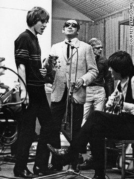 Jagger, Richards and Oldham (background) in the studio with Lionel Bart, songwriter, pop impresario, and composer of the hit musical <i>Oliver!</i>