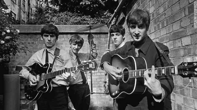 "The Beatles take a break in the back yard of Abbey Road while recording their first hit ""Please Please Me"". <!-- --> </br><!-- --> </br>Acclaimed British photographer Terry O'Neill built his reputation capturing the spirit of the Swinging Sixties. Here he gives a sneak preview of rare and unseen shots from his forthcoming London exhibition ""1963: Year of the Revolution""."