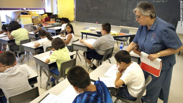 A teacher assists third-grade students in a Chicago classroom.