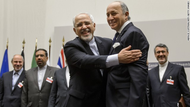 Iranian Foreign Minister Mohammad Javad Zarif, left, and French Foreign Minister Laurent Fabius react after the announcement.