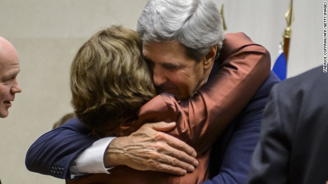 EU foreign policy chief Catherine Ashton and U.S. Secretary of State John Kerry embrace after the statement.