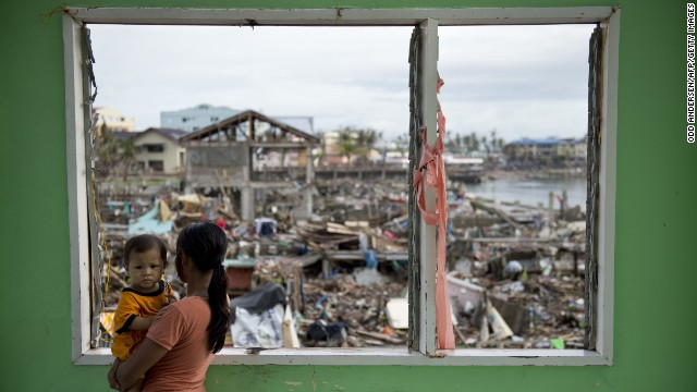 A woman looks over the devastated waterfront in Tacloban on November 24.