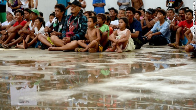 In an evacuation center in Tacloban, storm survivors watched Philippin