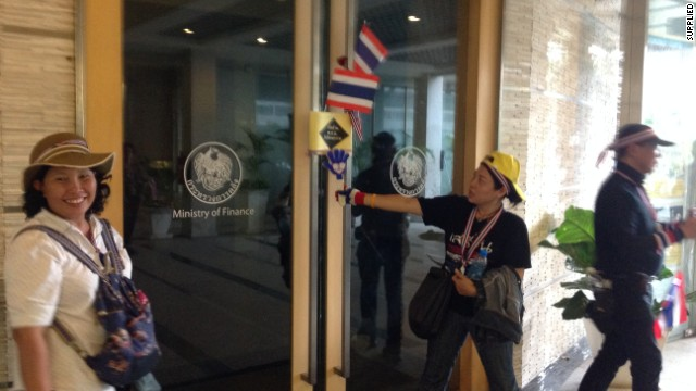 Anti-government protesters enter the Thai Finance Ministry on Monday, as tens of thousands of anti-government demonstrators marched through the tense Thai capital.