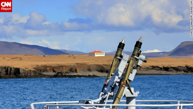 Military armaments are juxtaposed with Reykjavik's idyllic scenery as Navy ships from five countries practiced exercises with the Icelandic Coast Guard. See more photos on <a href='http://ireport.cnn.com/docs/DOC-971373'>CNN iReport</a>.