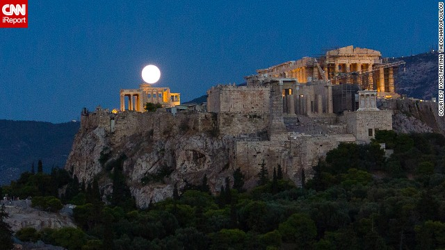 A full moon glows over the Acropolis in Athens.
