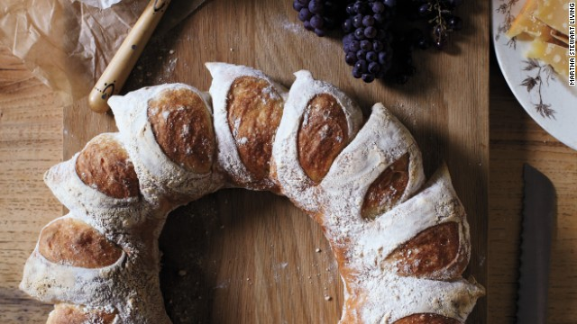 A circular loaf mimics the look of the corn-husk wreath—and a clever cutting technique creates radiant sections. When it's time to eat this centerpiece-worthy bread, it easily breaks into perfect portions. <strong>Supplies: </strong>Bread dough, All-purpose flour, Scissors <strong>How-to:</strong> 1. Punch into center of dough and make a hole, using your fingers to pull dough into a ring shape. 2. Generously dust top of dough with flour. Holding scissors at a 45-degree angle, snip a deep V into top of ring. Repeat every inch or so around ring. 3. Gently lift each snipped portion and splay outward, creating rays. Bake wreath.