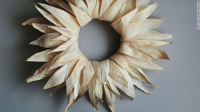 Homespun holiday: This wreath is a rustic nod to the harvest season, and it's made with tamale wrappers from the grocery store. <strong>Supplies: </strong>Corn husks, Bowl of water and paper towels, Straw wreath, T pins, Glue gun, Scissors
