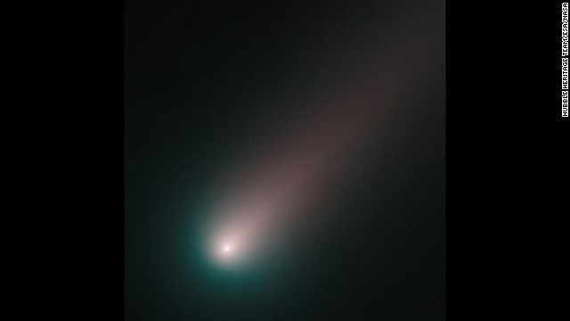 Comet ISON is seen through blue and red filters on November 2.