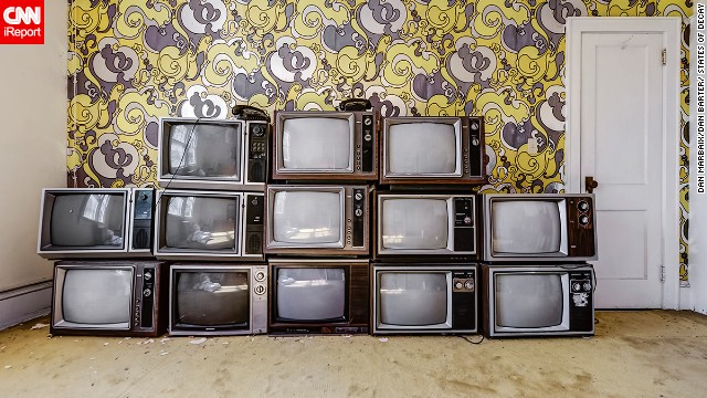 The photographers say they didn't stage photos for this series, making this arrangement of televisions in a New York hotel all the more curious.