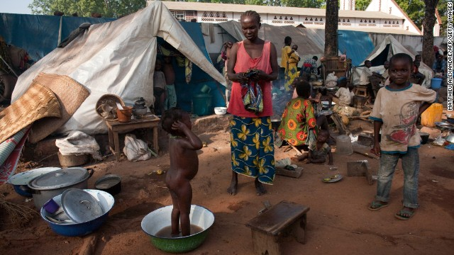A woman and children are shown at a camp for internally displaced people in the Central African Republic on November 9.