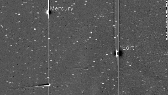 Comet ISON, with Comet Encke ahead, is pictured along with Mercury and Earth in this image taken by NASA's solar-observing STEREO spacecraft on Friday, November 22.