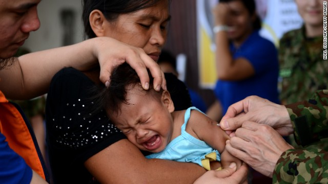 A baby receives a measles vaccine in Tacloban, Leyte province, on Wednesday, November 27. Haiyan, one of the strongest storms in history, has affected 4.3 million people in the Philippines, and many of them rely on emergency relief for food and water. See how you can help.